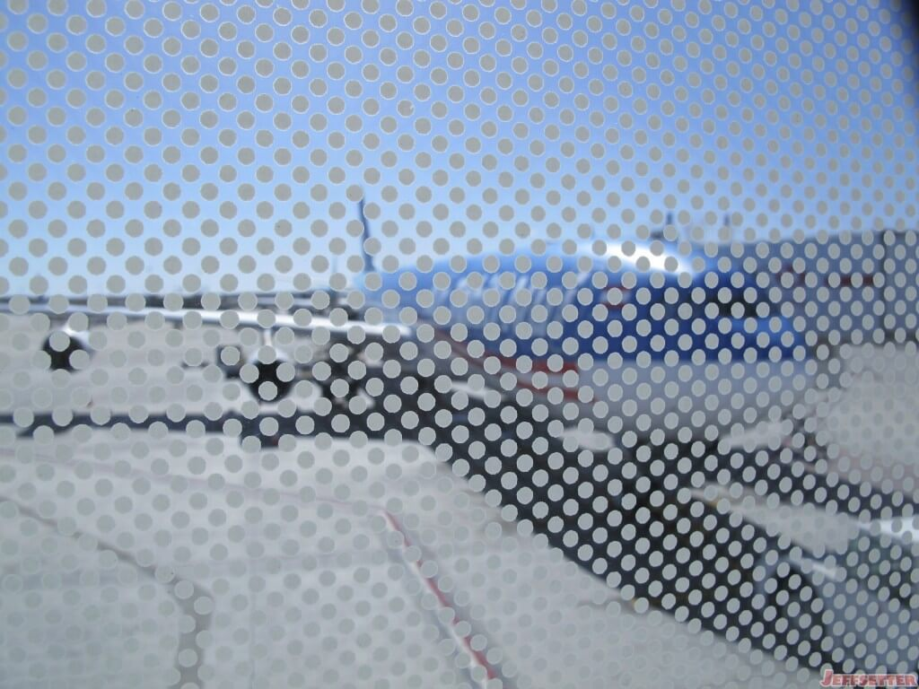 I finally get a view of the plane only to have it obscured by a window pattern