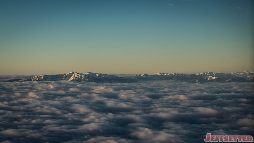 European Alps Emerging Throught the Clouds