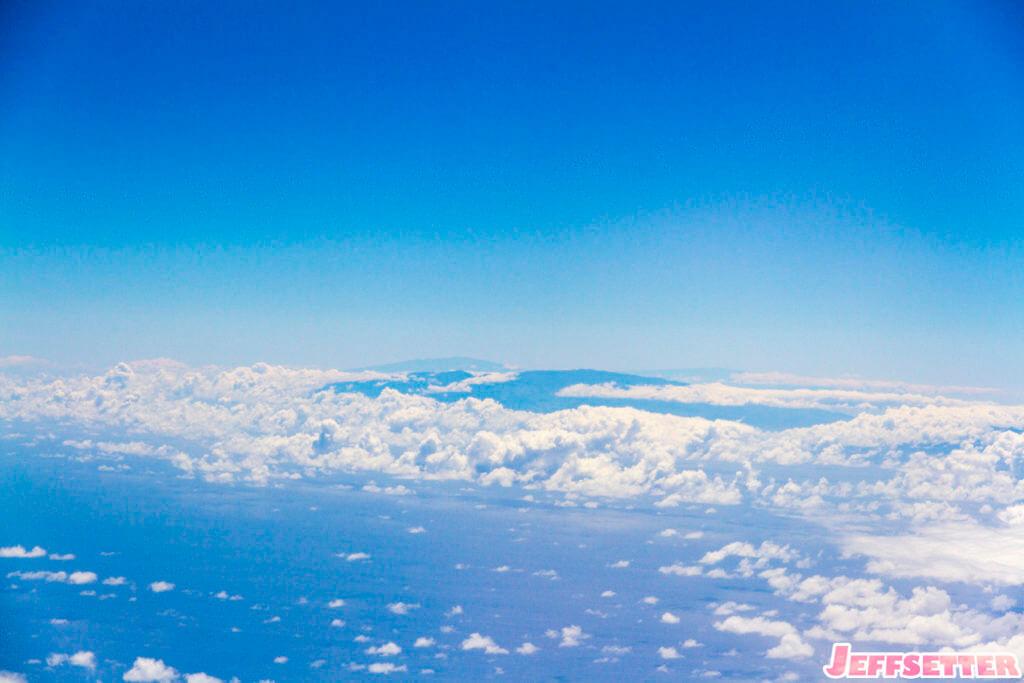Haleakala, Mauna Loa, and Mauna Kea off in the distance.
