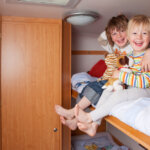 two children part of a family of five in a class c rv